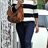 Lauren Conrad consults her BlackBerry while out for a stroll.