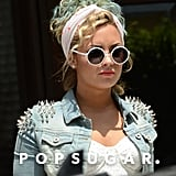 Demi Lovato wore white sunglasses.