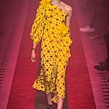 Marigold is a shade Michelle's worn more than once, and with her love for a one-shoulder or cold-shoulder silhouette, this flouncy design screams her name. Gucci Spring 2017.