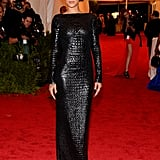 Rihanna posed in her black Tom Ford gown.
