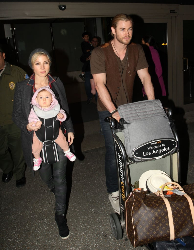 Chris Hemsworth was in charge of the luggage while his wife, Elsa Pataky, carried their daughter, India, through LAX on Sunday. It's been an exciting 2012 for Chris, who starred in Snow White and the Huntsman, reprised his role of Thor in The Avengers, and welcomed his adorable baby girl in May. Lucky for us, Chris also stripped down and landed in our best celebrity shirtless moments of the year. Chris's brother Liam had his own exciting headlines to celebrate, like getting engaged to Miley Cyrus. With the two Hemsworth boys both in California for Christmas, perhaps they'll be spending it together. The guys are also going head to head in our sexiest man of the year poll, though currently Chris needs your help if he is going to beat Ryan Gosling.