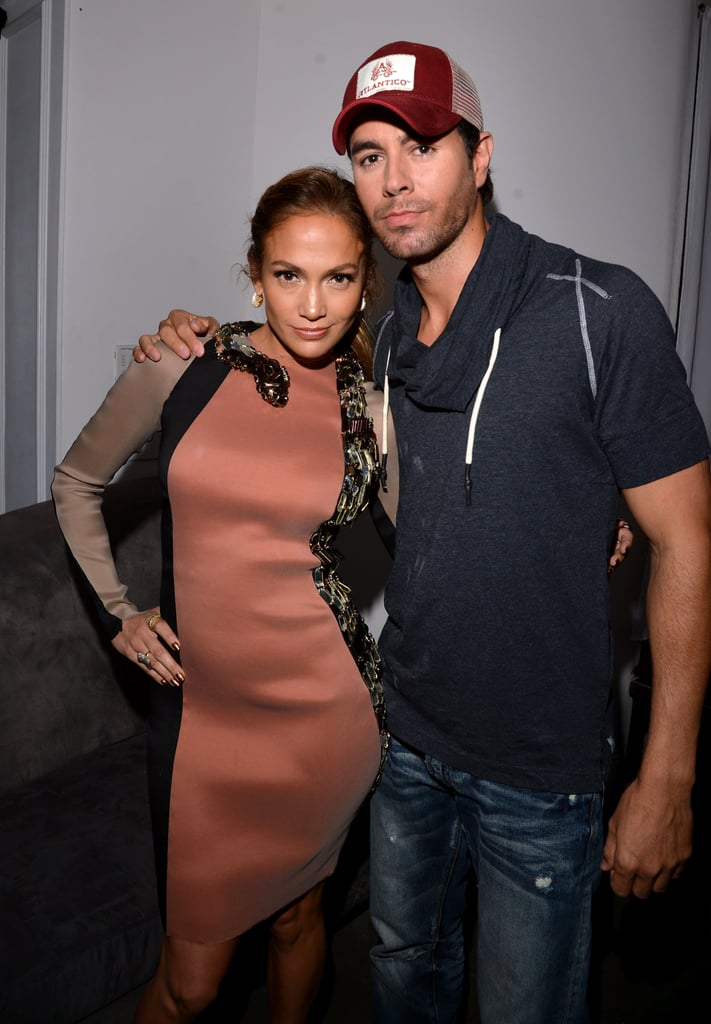 Enrique Iglesias and Jennifer Lopez posed at a press conference to announce their Mega tour.