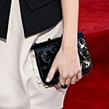 To complete her monochromatic palette, Emma added a black patent Fendi clutch to her ensemble.