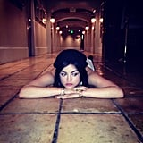 Lucy Hale looked thoughtful while lying in a hallway. Source: Instagram user lucyhale89