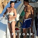 It's Not Chrissy Teigen's White Bikini That Steals the Spotlight — It's What She's Wearing With It