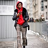 Team Your Black Boots With Plaid Pants and a Red Hoodie