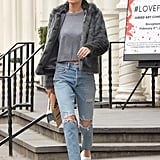 A little luxe via Gigi's jacket and cat-eye shades dressed up a pair of distressed jeans and sneakers.