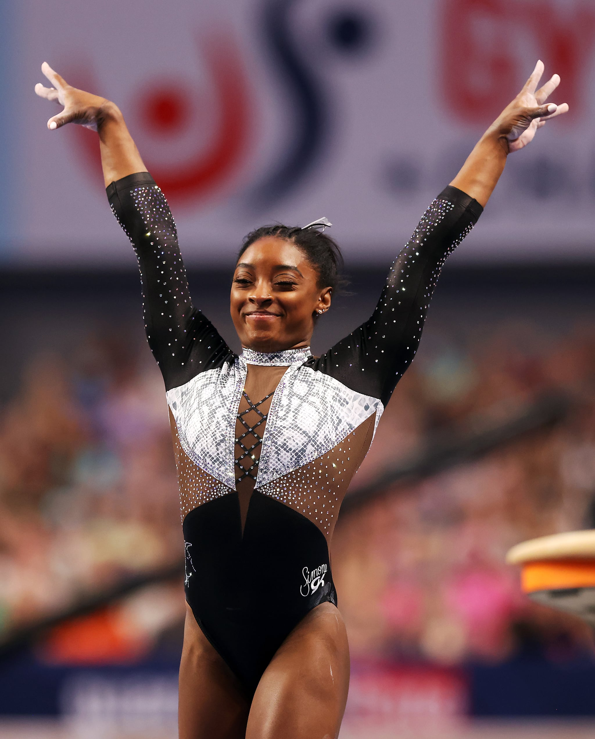 FORT WORTH, TEXAS - JUNE 06:  Simone Biles reacts after compteting on the vault during the Senior Women's competition of the U.S. Gymnastics Championships at Dickies Arena on June 06, 2021 in Fort Worth, Texas. (Photo by Jamie Squire/Getty Images)