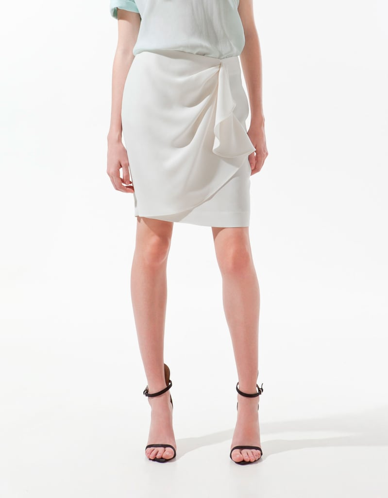 A sleek wrap skirt fitting for a Summer rooftop soiree.  Zara Front Gathered Skirt ($60)