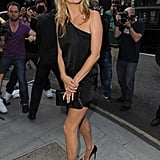 The star of the show – Kate Moss! She was all smiles as she arrived in a one shoulder LBD and stiletto heels. Check out more photos here.