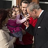 A young girl pinched Prince Charles's nose when he visited Tottenham on Wednesday.