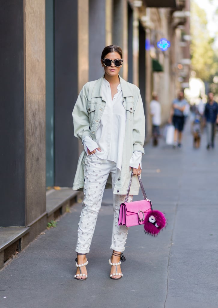 In a bold, pearl-embellished style with a cool jean jacket