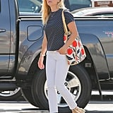 Reese plays up her polka dots with white denim and neutral espadrilles, not strappy black pumps.