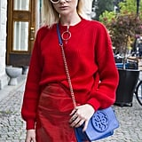 Style an all-red outfit when you pair leather with a ribbed knit. Strike a contrast with a cobalt blue bag.