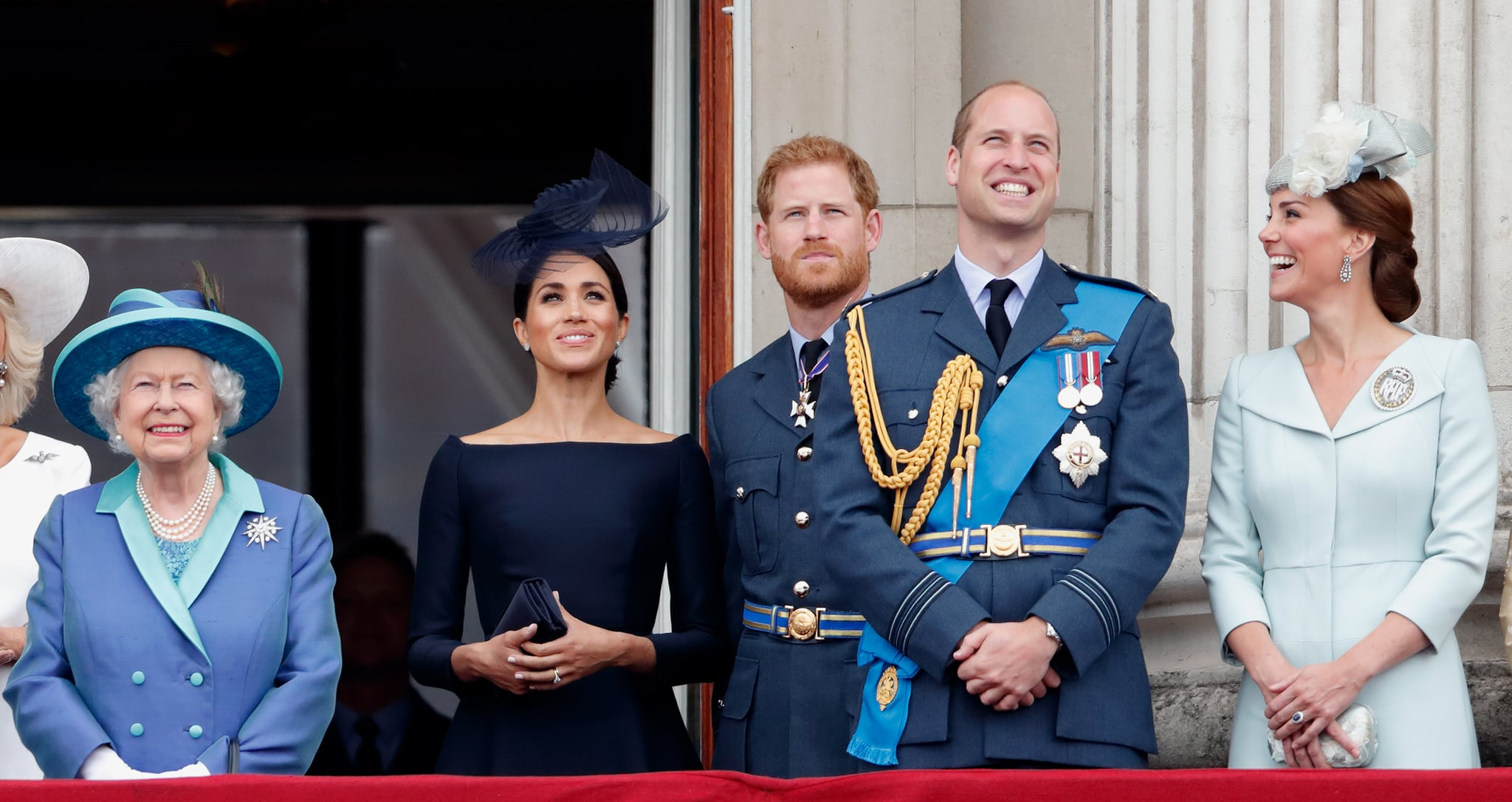 LONDON, UNITED KINGDOM - JULY 10: (EMBARGOED FOR PUBLICATION IN UK NEWSPAPERS UNTIL 24 HOURS AFTER CREATE DATE AND TIME) Queen Elizabeth II, Meghan, Duchess of Sussex, Prince Harry, Duke of Sussex, Prince William, Duke of Cambridge and Catherine, Duchess of Cambridge watch a flypast to mark the centenary of the Royal Air Force from the balcony of Buckingham Palace on July 10, 2018 in London, England. The 100th birthday of the RAF, which was founded on on 1 April 1918, was marked with a centenary parade with the presentation of a new Queen's Colour and flypast of 100 aircraft over Buckingham Palace. (Photo by Max Mumby/Indigo/Getty Images)