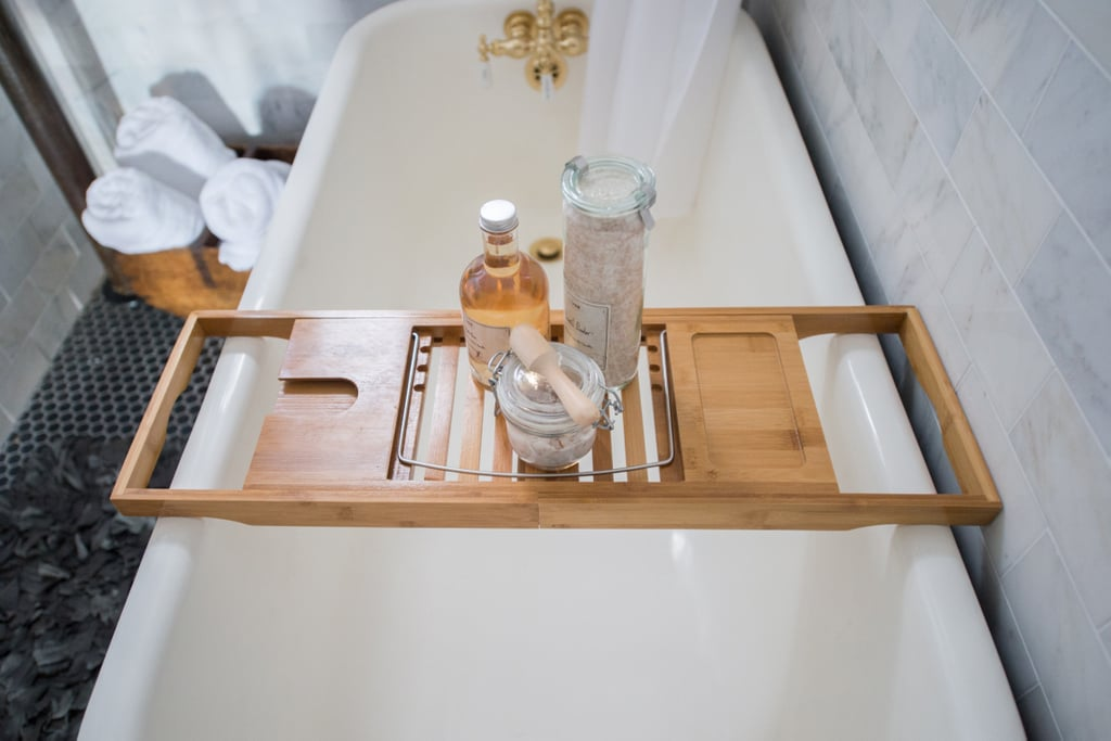 A bath tray makes it easy to keep products (or even a good read) dry and at the ready during bath time.  Photo by Samantha Goh via Homepolish