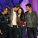 Robert Pattinson and Kristen Stewart at a Breaking Dawn Part 1 fan event with Taylor Lautner.