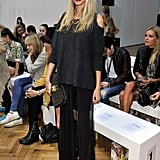 Poppy Delevingne channeled a moody Fall look in a sheer, split maxi, charcoal knit, and a dark burgundy lip at Sass & Bide.