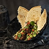 """This Felucian Garden Spread, or a plant-based kefta """"meatball"""" dish with herb hummus and tomato-cucumber relish with pita bread, can be found at Docking Bay 7 Food and Cargo."""