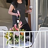 Jennifer Lawrence and a friend relaxed with a bottle of wine on the balcony of her hotel in Hawaii.