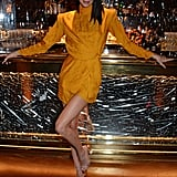 Kendall made her legs look longer than ever before by styling this high-neck, canary-yellow minidress with a sexy pair of PVC sandals. The fabric on the front of her dress was so short, she had to hold it down while walking to make sure she didn't reveal, well, ya' know.