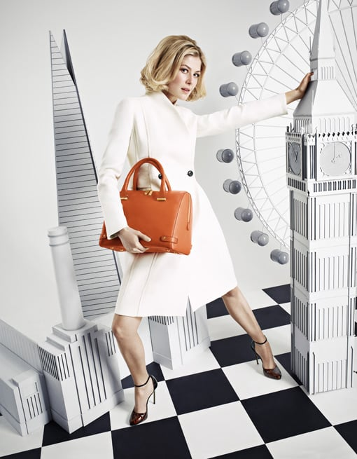 """Rosamund Pike worked closely with the LK Bennett design team for six months to create her Autumn 2013 collection. """"I think having a handbag is about feeling that you are holding a little bit of luxury and hopefully that is what this bag will offer,"""" she said.  Source: LK Bennett"""
