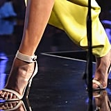 Beyonce'e nude-hued Givenchy heels added enough sexy oomph without complicating an already-bold color palette.