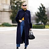 Tuck a Yellow Turtleneck Sweater Into a Pair of High-Waisted Jeans