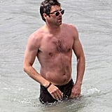 Patrick Dempsey wore his sunglasses during a dip in the water.