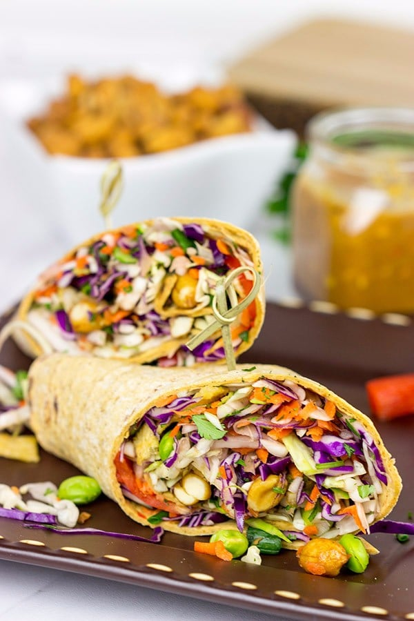 A healthy veggie wrap recipe with avocado, hummus, spinach, carrots, cucumber and feta cheese. Find this Pin and more on SANDWICHES | WRAPS by Jessica | The Forked Spoon. Find gluten free tortillas - Veggie wraps: Go lighter on the mustard (or skip it altogether) and these are .