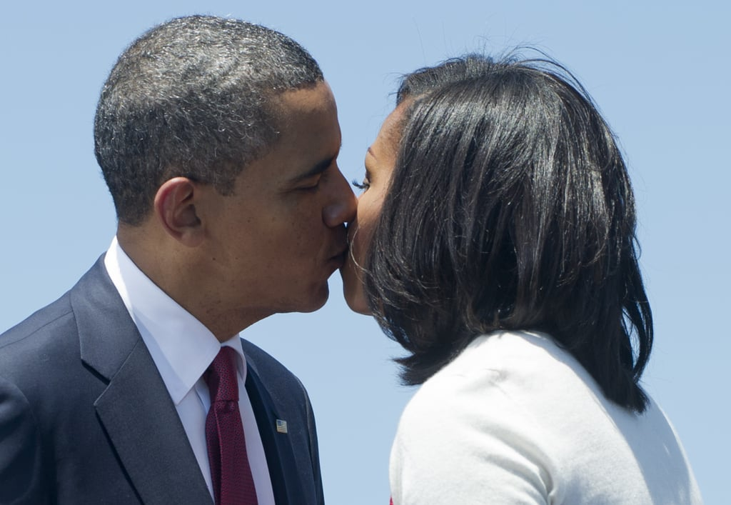 The Obamas shared a kiss during a campaign event.