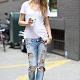 Distressed jeans made a cool counterpoint for a classic white tee and a fedora. Source: Greg Kessler