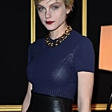 Jessica Stam paired a navy dress with a wide black belt and a gold chain necklace at the H&M show.