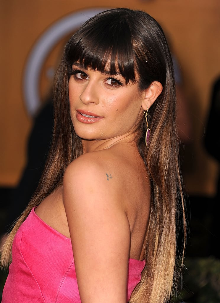 Lea Michele sure loves getting inked. Back in 2012, the actress told Hong Kong's Prestige magazine that she had a whopping 14 tattoos. While many of them are hidden or supertiny, the actress recently added two new designs to her extensive collection: a coffee cup in memory of her grandmother and a number five for late boyfriend Cory Monteith. Keep reading for a closer look at Lea's ink, and then check out our ultimate celebrity tattoo gallery.