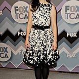 For Fox's All-Star Party, Zooey chose a black and white printed Naeem Khan number, which she then paired with a sweet bow-tie belt, black tights, and black pumps.