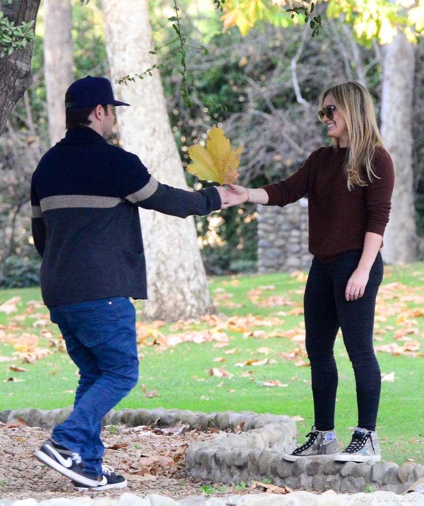 """Hilary Duff and Mike Comrie announced their separation today, but just yesterday the duo met up at an LA park with their nearly 2-year-old son, Luca. Hilary and Mike sat on a bench to chat while Luca played, and later the couple was seen walking in the grass and exchanging smiles as they played with leaves. It's clear that their split is amicable, as their rep shared in a statement: """"They remain best friends and will continue to be in each other's lives. They are dedicated to loving and parenting their amazing son and ask for privacy at this time."""""""