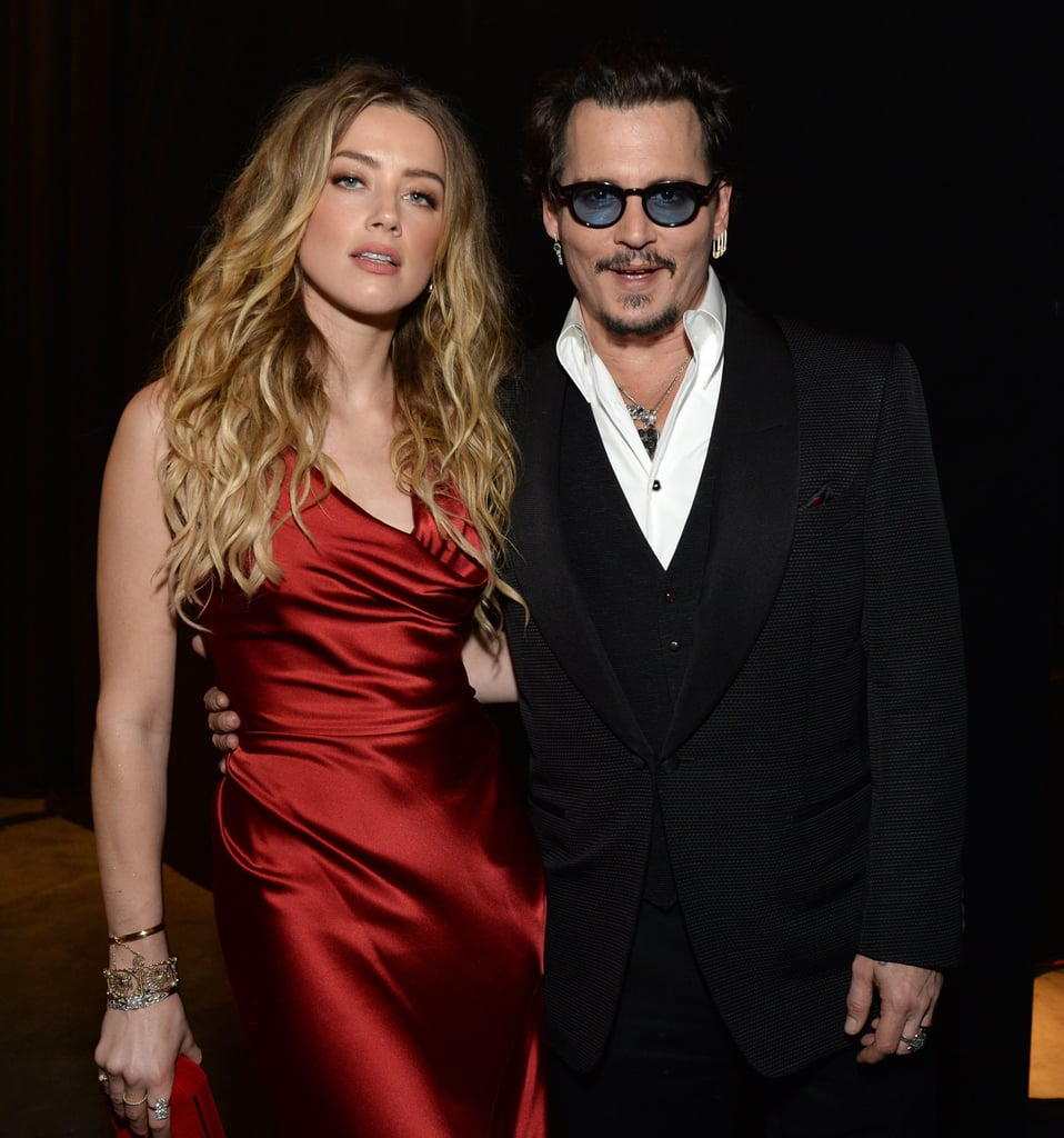 After nearly a year of marriage, Johnny Depp and his wife, Amber Heard, are still completely head over heels for each other. On Saturday night, Johnny hit the red carpet at the Art of Elysium Heaven Gala in LA with Amber by his side. The two nearly lit the red carpet on fire as they struck poses for photographers before heading inside and showing sweet PDA at their dinner table. Also in attendance was Johnny's ex-girlfriend and former What's Eating Gilbert Grape costar, Juliette Lewis, who Johnny linked up with at the event. The gala honored legendary fashion designer Vivienne Westwood and brought out a handful of other stars, including Ian Somerhalder, wife Nikki Reed, and Paul Wesley. Read on to see more photos of the stunning pair, and then see how the rest of Hollywood kicked off Golden Globes weekend!