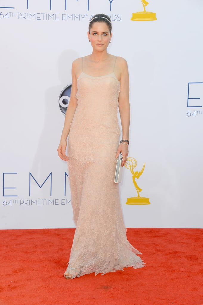 Actress Amanda Peet walked the Emmys red carpet in a stunning nude gown.