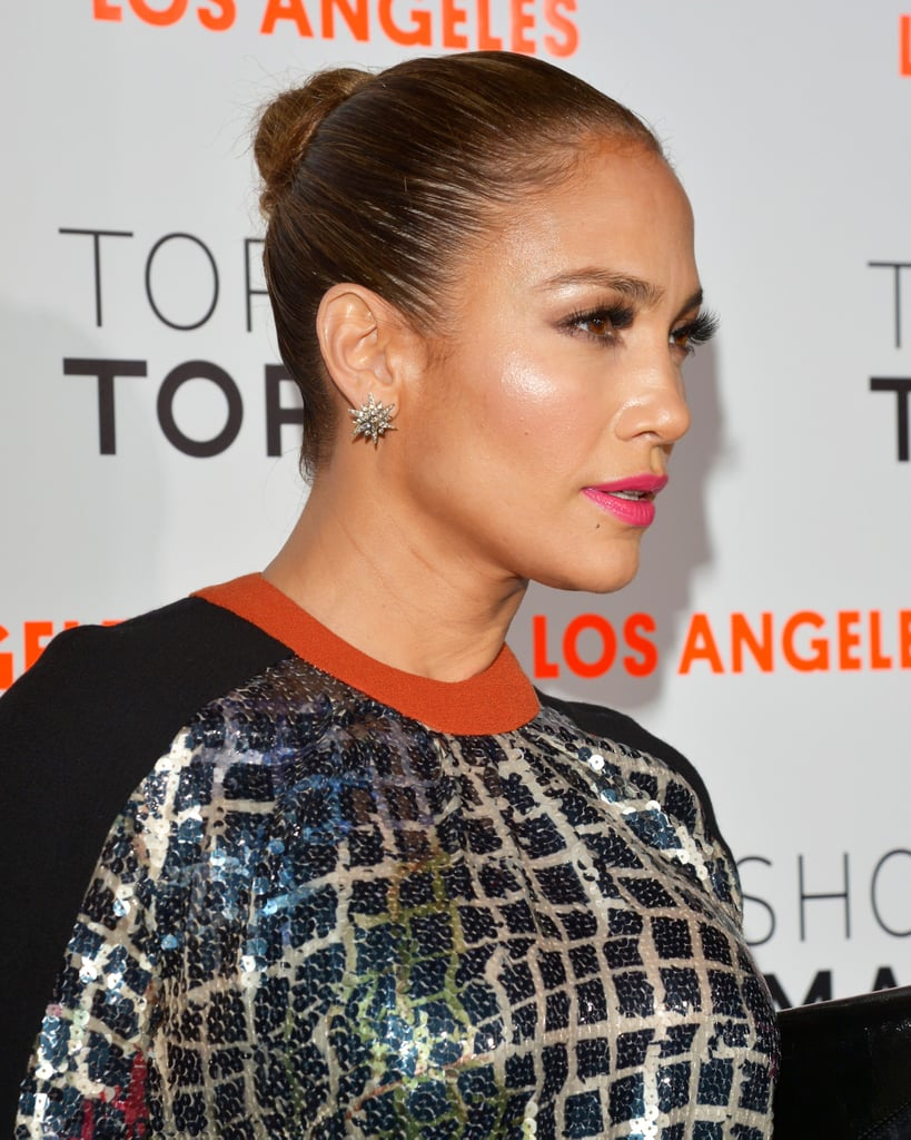 Whether it's to disguise a not-so-stellar hair day or just to get a chic look, a slicked-back bun — like this one, which Jennifer Lopez recently wore — manages maximum drama with minimal effort. Be sure to use a brush or comb to ensure every piece of hair is pulled back seamlessly before twisting your strands into a bun. Finish with a gel or hairspray to seal the look.