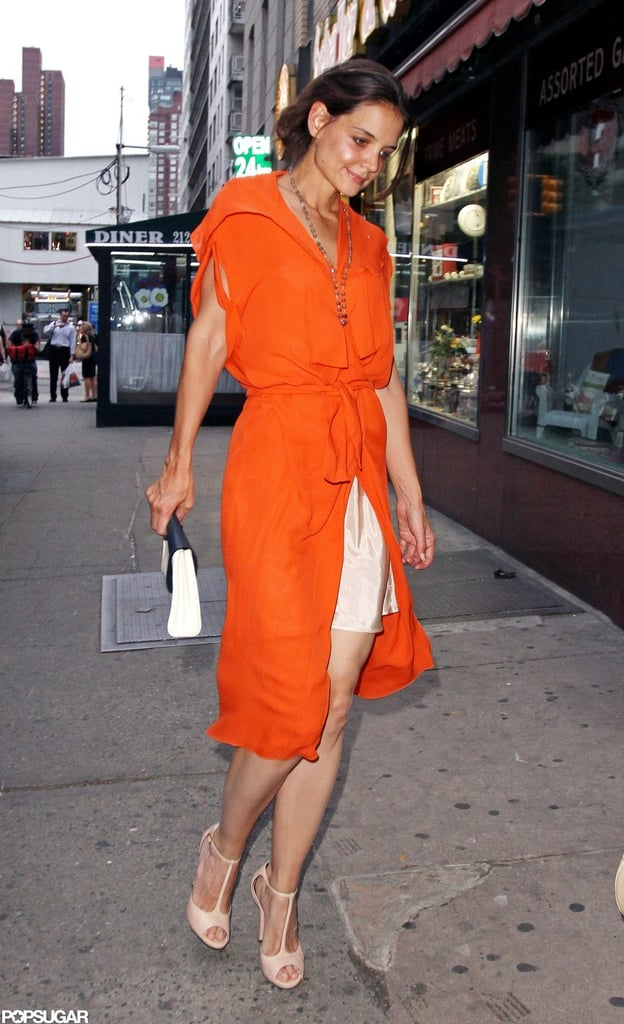 Katie Holmes showed some leg, and a bit of her slip, yesterday while out getting coffee with her mom Kathleen Holmes at the Two Little Red Hens bakery in NYC. The Holmes women wrapped up a big week, in which Katie finalized her split from ex Tom Cruise. Katie and her daughter Suri Cruise have moved into a new apartment in the city's Chelsea neighborhood, and have apparently already even found a new Catholic church in their neighborhood. While Kate and Suri visit favorite Big Apple spots like Chelsea Piers, the Children's Museum, and the Central Park Zoo, Tom's been working in California. Tom is still on the Northern California set of Oblivion, wrapping up production on the blockbuster alongside costar Olga Kurylenko.