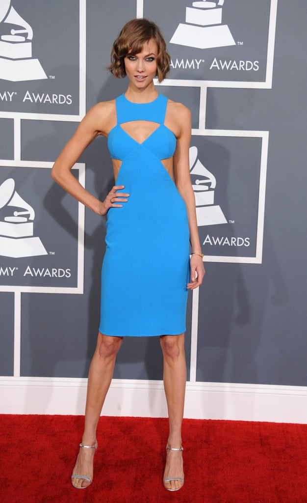 Karlie Kloss wore a bright blue cut-out dress from Michael Kors on the red carpet at this today's Grammys in LA. She's best known as a model, but today Karlie's trying out a new gig — she's conducting on-air interviews for MTV's House of Style! She set the fashion stakes high in the Michael Kors dress, which has been seen on other celebrities, like Gwyneth Paltrow, before. What do you think of Karlie's gown? Be sure to weigh in on all of our Grammys fashion and beauty polls.