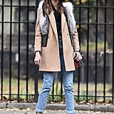 For a fun spin, wear your favorite vest over another coat. Thania Peck styled her cropped Thomas Wylde fur vest over a Topshop beige coat for that fashion girl touch.