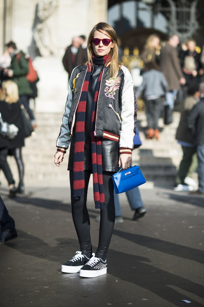 It's not easy to tie together an embroidered bomber, studded kicks, leather, and a rugby-striped scarf, but this showgoer pulled it all together seamlessly. Source: Le 21ème | Adam Katz Sinding