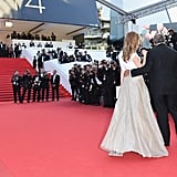 Amber Heard walked the red carpet with jewelry designer Fawaz Gruosi at the Two Days, One Night premiere.