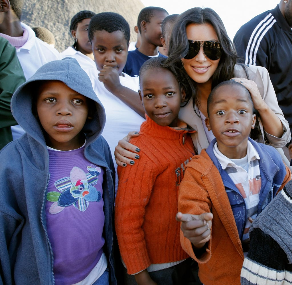 She posed with local children during a visit to the Motswedi Rehabilitation Centre in Botswana in July 2009.