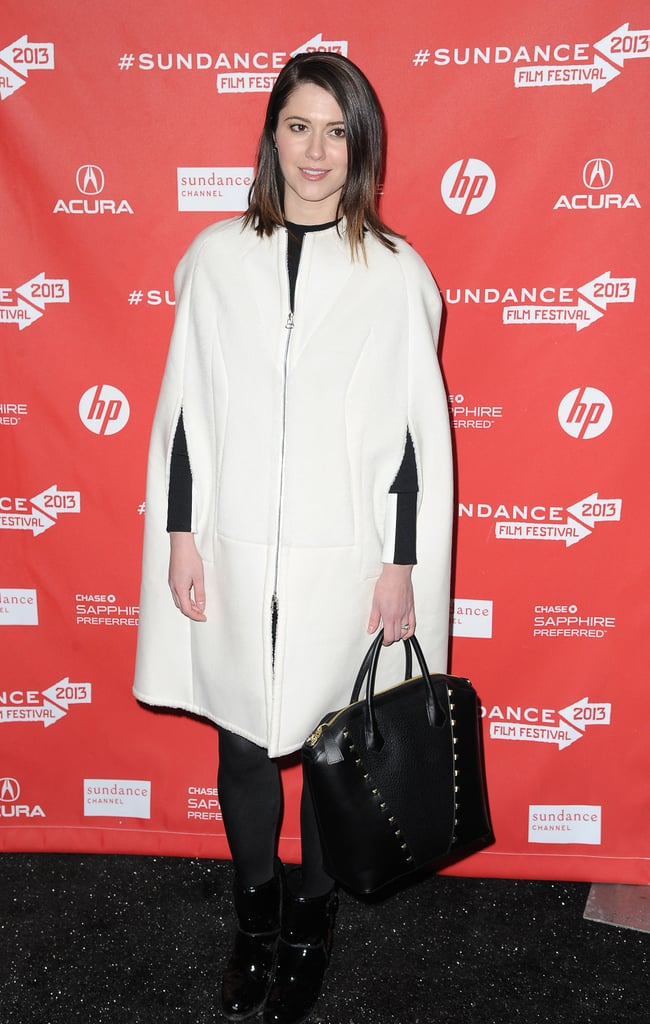 Mary Elizabeth Winstead took a more feminine approach to her Winter ensemble, pairing a white car coat with a chic black tote.
