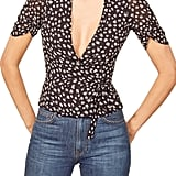 You can wear this Reformation Floral Wrap Blouse  ($77, originally $128) with your favorite jeans.