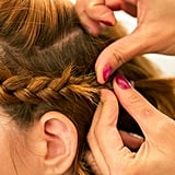 Once you finish curling the middle section, pull back your braid behind your ear and pin it in place using two bobby pins to form an X shape. Source: Caroline Voagen Nelson