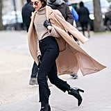 A Beige Turtleneck, Peach Coat, Black Cropped Jeans, and Leather Boots