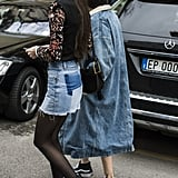 Diletta Bonaiuti in a patchwork miniskirt at Milan Fashion Week.